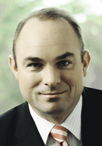 Dr. Peter Charissé, Anga Com
