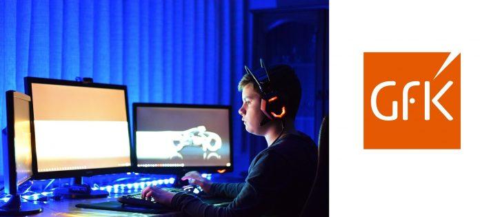 Kind spielt am Computer, Logo GfK